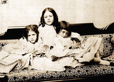 Alice Liddell (right) with sisters circa 1859 (photo by Lewis Carroll)