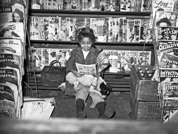 "Girl reading comic book in newsstand by Charles ""Teenie"" Harris, 1940"